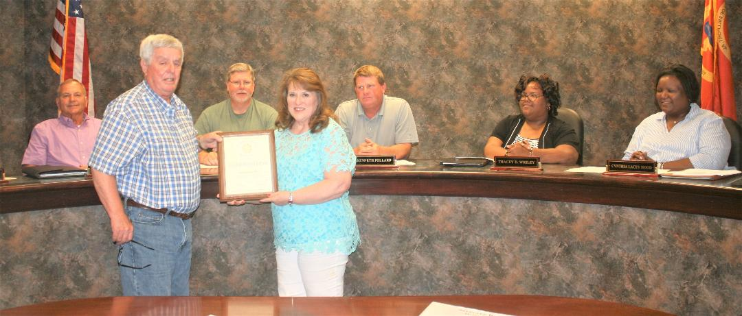 Mayor Allred presented Clerk Ferguson a plaque and a proclamation to mark her accomplishment.